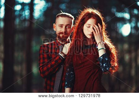 The Red-haired Guy With A Beard And Curly Red-haired Girl On The Background Of Fabulous Scenery Of N
