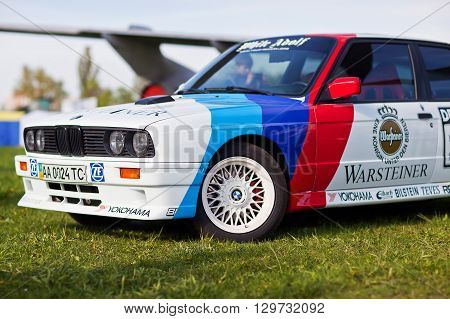 KYIV UKRAINE - April 22 2016: Car BMW e30 M3 at festival of vintage cars OldCarLand-2016 in Kiev. Side view in front.