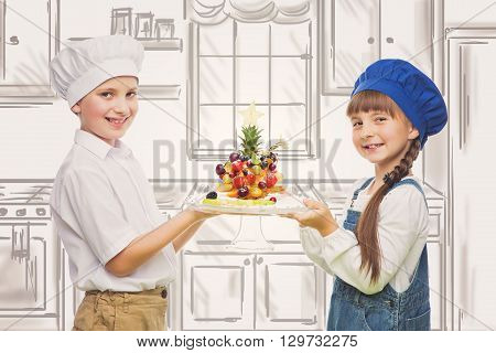 Little boy and girl holding tree shape fruit snack selfmade. Isolated over white background. Copy space.