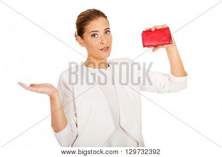Shocked businesswoman looking into her empty wallet
