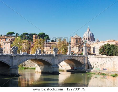 St. Peter's cathedral over bridge and Tiber river in Rome, Italy