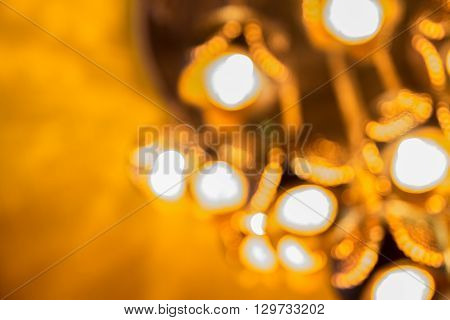 Defocus chandelier made from coconut shell hang under yellow ceiling