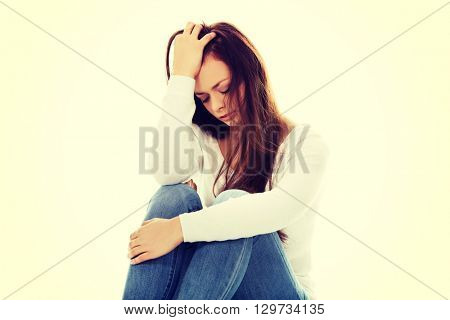Young depression woman sitting on the floor