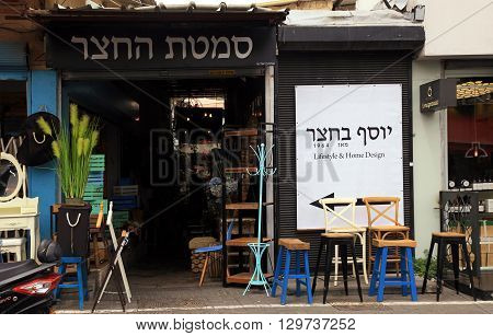 TEL AVIV-YAFO, ISRAEL - APRIL 5, 2016: Vintage furniture and other staff at entry to shop at Jaffa flea market district in Tel Aviv-Jaffa, Israel. Jaffa flea market is popular attractions for tourists and locals.
