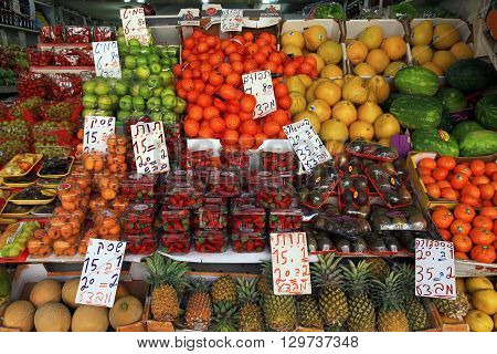 TEL AVIV, ISRAEL - APRIL 7, 2016: Fresh fruits are sold in the outdoor Carmel Market in Tel Aviv, Israel.
