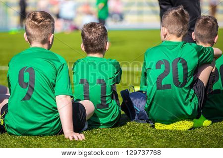 A sports team with young athletes. Young football soccer team in sportswear.