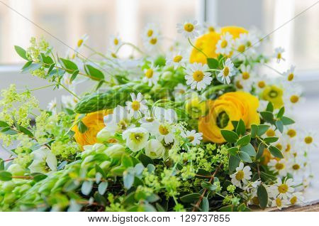 Bouqet of spring yellow and green flowers