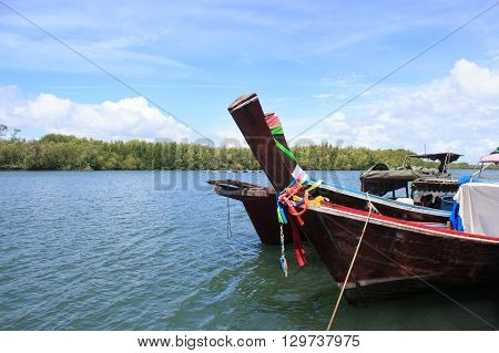 head of side view wooden boat in the tropical-andaman sea Trang Thailand