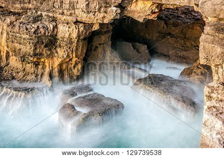 The sea hits the rocks in the tourist attraction of Chasm of Hell's Mouth (In Portuguese