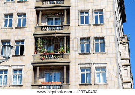 decorated balconies of old socialist buildings in central berlin