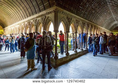 Mont St. Michel France - May 22 2012: Normandy tourists in the cloister of the abbey.