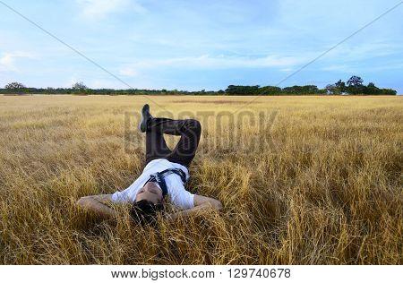 Young Asian Man Relaxing On Savanna