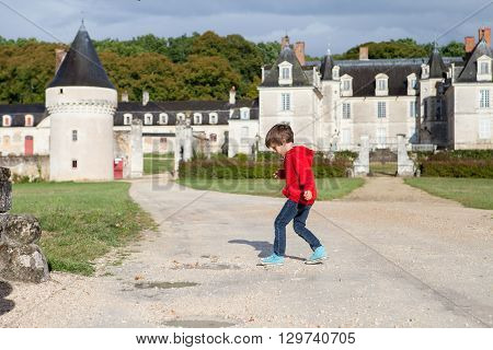 Two Boys, Happily Playing After The Rain On The Driveway Of French Gizeux Castle