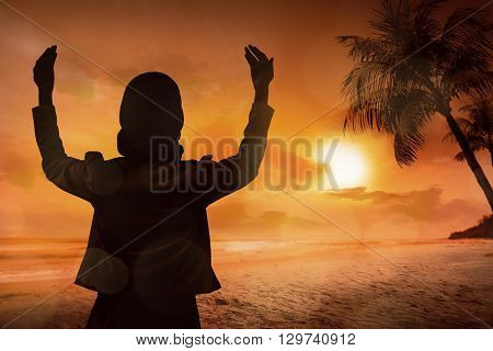 Young Muslim Woman Praying On The Beach