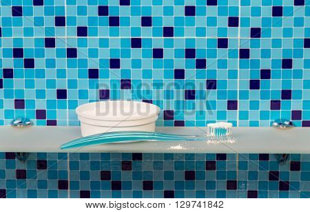 Tooth powder and brush on the background of bathroom