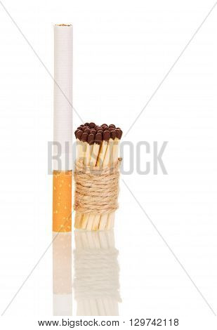 Cigarette and matches associated with string isolated on white background