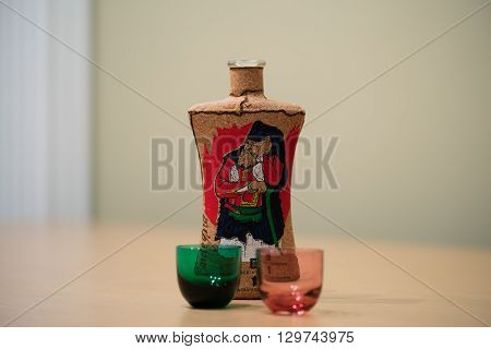 an italian liqueur and two colored glasses