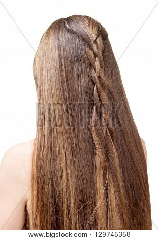 Well-groomed, beautiful hair of a young girl partially braided in a braid. Isolated on white background.