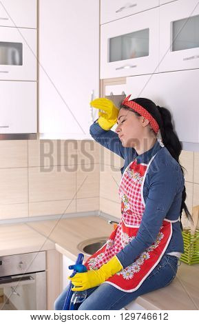Cleaning Lady Restng On Kitchen Countertop