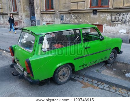 BRNO CZECH REPUBLIC - CIRCA MAY 2016: Green Trabant car parked in a street of the city centre