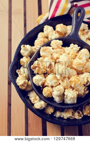 Homemade crunchy caramel popcorn ready for use. Selective focus.