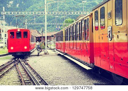 Wilderswil Switzerland - July 08 2012: Retro passenger trains stan after arrival from Schynige Platte.