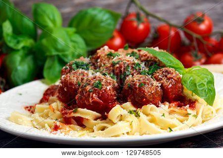 Italian Pasta spaghetti with meatballs in tomato sauce.