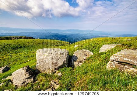 Huge Stones In Valley On Top Of Mountain Range At Sunrise