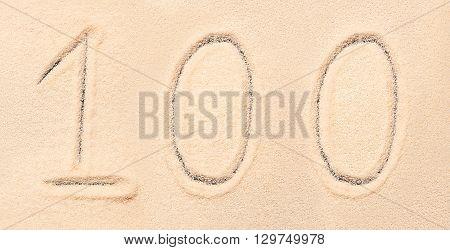 100 Number Written On Beach Sand. Summer Background