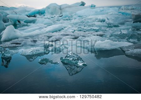 Climate change and global warming. Glacier melting in Iceland. Floating icebergs in Jokulsarlon lagoon.