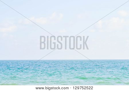 sea sky and could in blur background
