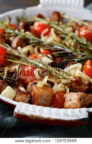 Roasted Pork Meat With Rosemary, Tomato And Onion On Frying Pan