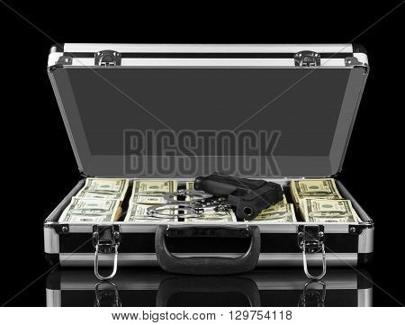 Opened case with dollars weapons and handcuffs isolated on a black background.