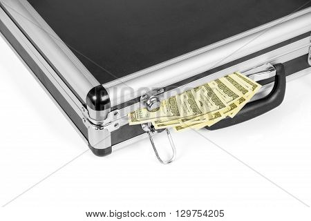 Full suitcase with hundred dollar bills isolated on white background.