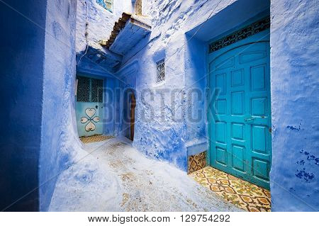 Detail of doors and a window in the town of Chefchaouen in Morocco