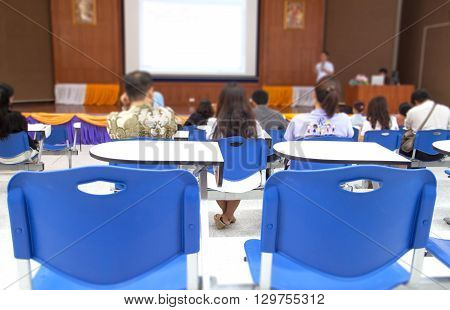 blurred at Business photo of conference hall or seminar room with attendee background