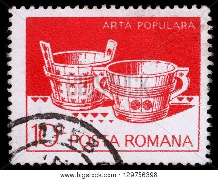 ZAGREB, CROATIA - JULY 19: A stamp printed in Romania shows Wooden tubs from Hunedoara and Suceava, circa 1982, on July 19, 2012, Zagreb, Croatia