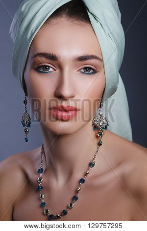 Eastern stylish model girl with a turban on his head. Jewels