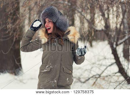 Beautiful Woman Playing Snowballs