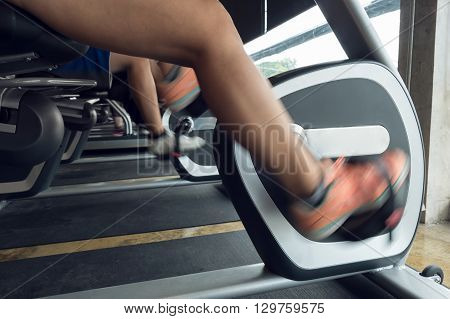 Woman Exercise Riding Bicycle In Fitness Center, Activity Of Healthy Care