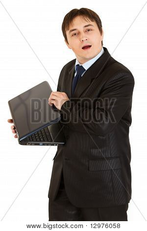 Secretive modern businessman hiding laptops screen isolated on white
