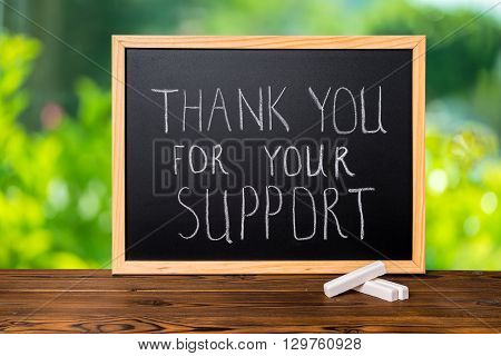 Handwriting Text Thank You For Your Support Is Written In Chalkboard On Green Light Background And R