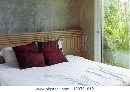 bedroom interior design modern style with white mattress and red pillow and wooden headboard