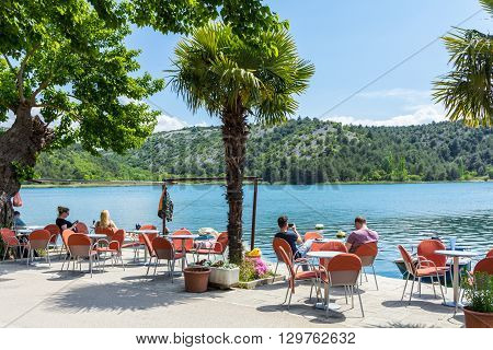 Skradin Croatia - May 05 2016: tourists sitting at a waterside cafe