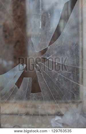 sharp pieces of broken glass in the window