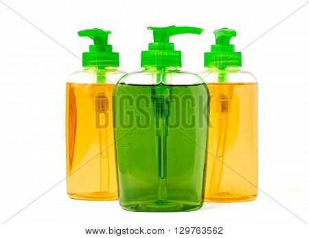 Three liquid soap dispenser plastic bottles isolated on white