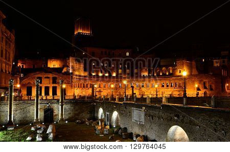 View of the Trajan's Forum at night with Basilica Ulpia columns and Tower of the Militia