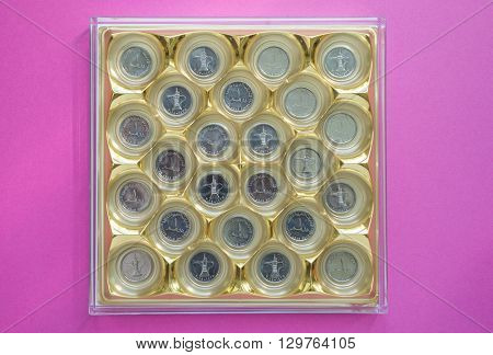 One UAE Dirham coins placed in a chocolate box. Concept for 'diversified investment'.