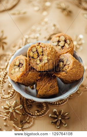 Pistachio stuffed baklava sweet rolls. A mediterranean sweet.