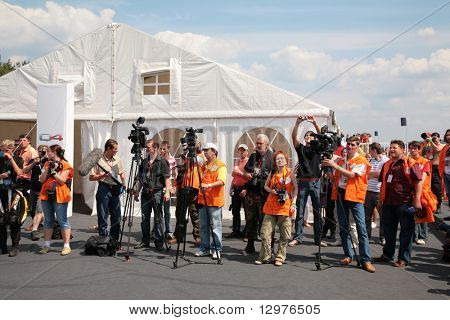 "MOSCOW - JUNE 22: Photographers and press on The second stage of the Championship of Russia June 22, 2008 in autodrome ""Miachkovo"", Moscow."